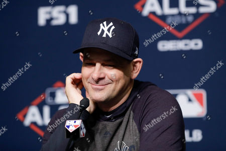 New York Yankees manager Aaron Boone answers questions during a news conference before Game 3 of baseball's American League Championship Series, in New York