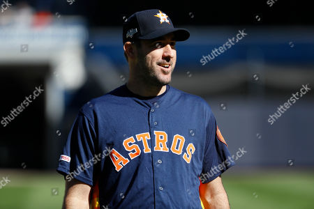Stock Photo of Houston Astros starting pitcher Justin Verlander walks on the field during batting practice before Game 3 of baseball's American League Championship Series against the New York Yankees, in New York