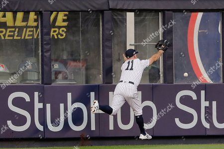 New York Yankees center fielder Brett Gardner (11) can't make the catch on a ball hit to the wall by Houston Astros' Martin Maldonado during the fourth inning of Game 3 of baseball's American League Championship Series, in New York