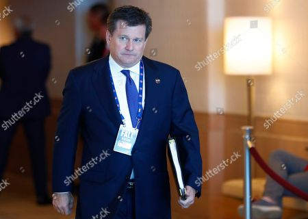 Michael Bidwill, President of the Arizona Cardinals, arrives at the NFL Fall League Meeting, in Fort Lauderdale, Fla