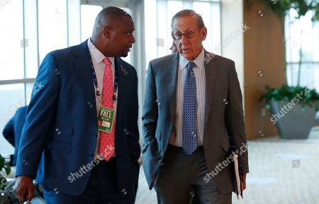 Stock Photo of Troy Vincent, Stephen Ross. NFL executive vice president Troy Vincent, left, chats with Miami Dolphins owner Stephen Ross as they leave the NFL Fall League Meeting, in Fort Lauderdale, Fla. NFL owners began two days of meetings Tuesday with formal bargaining talks on a new collective bargaining agreement expected to resume soon
