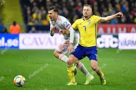 Spain's Dani Ceballos (L) and Sweden's Sebastian Larsson in action during the UEFA Euro 2020 Group F qualifying soccer match between Sweden and Spain at Friens Arena in Solna, Stockholm, Sweden, 15 October 2019.