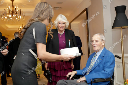 Stock Image of Camilla Duchess of Cornwall celebrates the birthday of Nicholas Parsons (R) as she attends a reception hosted by Gyles Brandreth, President of the Oscar Wilde Society, to mark the anniversary of the author's birth at the Grosvenor House