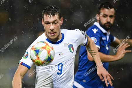 Italy's Andrea Belotti (L) fights for the ball with Liechtenstein's Daniel Kaufmann during the UEFA Euro 2020 qualifying, Group J soccer match between Liechtenstein and Italy in Vaduz, Liechtenstein, 15 October 2019.