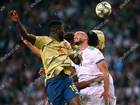 Algeria's Atal Gedouria Adlane, right and Colombia's Lerma Jefferson jump for the ball during their international friendly soccer match at the Stade Pierre Mauroy - Villeneuve d'Ascq stadium in Lille, France