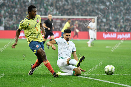 Colombia?s player Oscar Murillo in action against Algeria?s player Baghdad Bounedjah during the friendly international between Algeria vs Colombia at the Pierre Mauroy Stadium in Villeneuve-d'Ascq, near Lille, France, 15 October 2019.