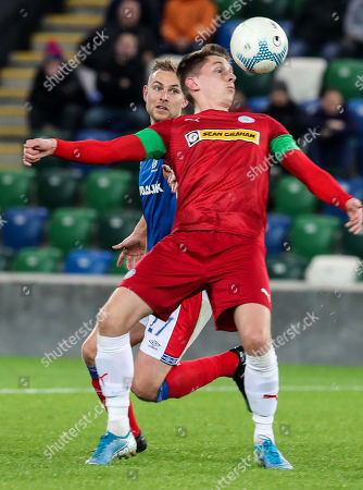 Linfield vs Cliftonville. Linfield's Andrew Mitchell with Ryan Curran of Cliftonville