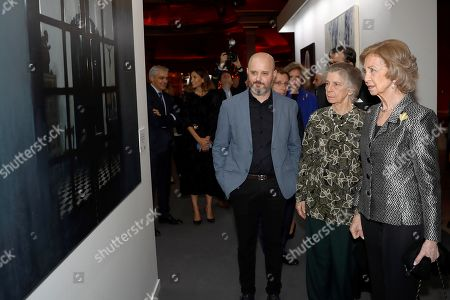 Stock Image of Spain's emeritus Queen Sofia (R) and his sister Irene (2-R) observe an artwork by Spanish artist Bernardino Sanchez Bayo (C) before the 34th BMW painting awards at Royal Theater in Madrid, Spain, 15 October 2019.
