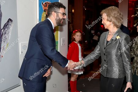 Spain's emeritus Queen Sofia (R) greets Spanish artist Javier Palacios Rodriguez (L), winner BMW painting award, before the 34th BMW painting awards at Royal Theater in Madrid, Spain, 15 October 2019.