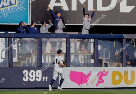 New York Yankees center fielder Brett Gardner (11) watches a home run ball by Houston Astros' Jose Altuve sail over the left field wall during the first inning of Game 3 of baseball's American League Championship Series, in New York