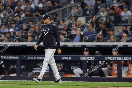 New York Yankees manager Aaron Boone walks onto the field to relieve starting pitcher Luis Severino during the fifth inning of Game 3 of baseball's American League Championship Series against the Houston Astros, in New York