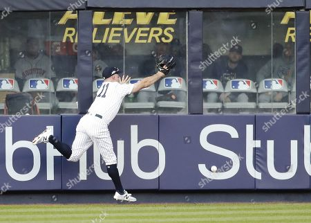New York Yankees left fielder Brett Gardner can't catch a double off the bat of Houston Astros batter Martin Maldonado in the top of the fourth inning of their MLB American League Championship Series playoff baseball game three at Yankee Stadium in the Bronx, New York, USA, 15 October 2019. The winner of the seven game playoff series will go on to face either the Washington Nationals or the St. Louis Cardinals in the World Series.