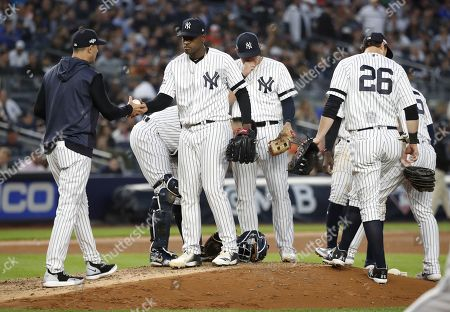 New York Yankees manager Aaron Boone (L) removes pitcher Luis Severino (2L) from the game in the top of the fifth inning of their MLB American League Championship Series playoff baseball game three at Yankee Stadium in the Bronx, New York, USA, 15 October 2019. The winner of the seven game playoff series will go on to face either the Washington Nationals or the St. Louis Cardinals in the World Series.
