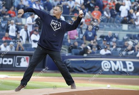 Stock Photo of New York Yankees pitcher Andy Pettitte throws out the ceremonial first pitch  before the New York Yankees play the Houston Astros in their MLB American League Championship Series playoff baseball game three at Yankee Stadium in the Bronx, New York, USA, 15 October 2019. The winner of the seven game playoff series will go on to face either the Washington Nationals or the St. Louis Cardinals in the World Series.