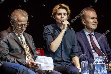 French activist and Director Caroline Fourest (C) speaks next to Syrian Kurdistan representative in France Khaled Issa (L) and French-Kurdish Cultural Institute Director Kendal Nezan (R), during a politic rally held by French supporters of the Kurdish community in Paris, France, 15 October 2019 to protest against the ongoing offensive launched by the army of Turkey in Northern Syria.