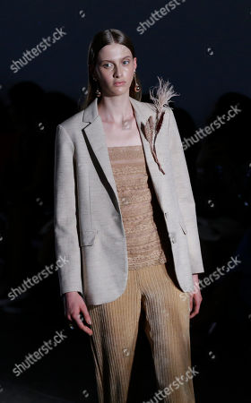 Stock Image of A model wears a creation from the Fabiana Milazzo collection during Sao Paulo Fashion Week in Sao Paulo, Brazil
