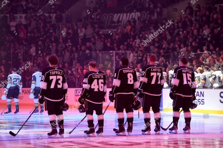 Tyler Toffoli, Blake Lizotte, Drew Doughty, Jeff Carter and Ben Hutton. The Los Angeles Kings starting line Tyler Toffoli (73), Blake Lizotte (46), Drew Doughty (8), Jeff Carter (77) and Ben Hutton (15) stand on the ice during the national anthem before an NHL hockey game against the Vegas Golden Knights, in Los Angeles