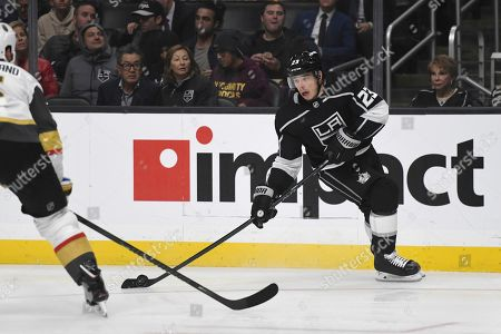 Los Angeles Kings right wing Dustin Brown (23) advances the puck against Vegas Golden Knights during an NHL hockey game, in Los Angeles