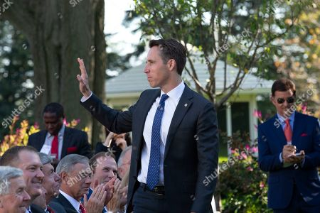 United States Senator Josh Hawley (Republican of Missouri) stands and waves as United States President Donald J. Trump hosts the St. Louis Blues, the 2019 Stanley Cup Champions, at the White House.