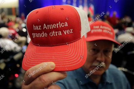 A.D. Smoot sells hats with the Make America Great Again slogan in Spanish before a panel discussion with Donald Trump, Jr., Trump campaign senior adviser Kimberly Guilfoyle, and Trump campaign manager Brad Parscale, in San Antonio