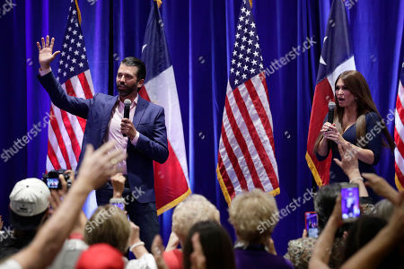 Stock Picture of Donald Trump Jr., Kimberly Guilfoyle. Donald Trump, Jr., left, and Trump campaign senior adviser Kimberly Guilfoyle, right, speak to supporters of President Donald Trump during a panel discussion, in San Antonio