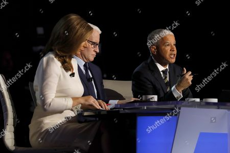 Stock Photo of Erin Burnett, CNN anchor, left, Anderson Cooper, CNN anchor, and Marc Lacey, New York Times national editor, right, listen during a Democratic presidential primary debate hosted by CNN/New York Times at Otterbein University, in Westerville, Ohio