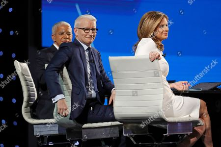 Marc Lacey, New York Times national editor, from left, Anderson Cooper, CNN anchor, and Erin Burnett, CNN anchor, wait for the start of a Democratic presidential primary debate hosted by CNN/New York Times at Otterbein University, in Westerville, Ohio