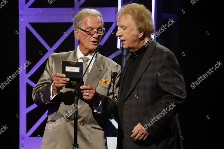 Pat Boone, Bill Gaither. Pat Boone, left, and Bill Gaither announce the winner of the song of the year award during the Dove Awards, in Nashville, Tenn
