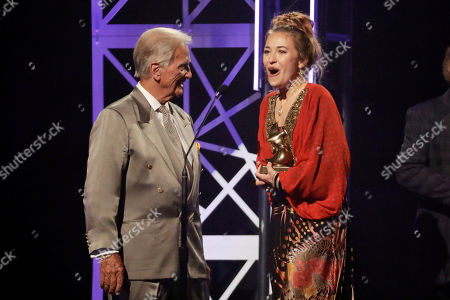 Lauren Daigle, Pat Boone. Lauren Daigle, right, accepts the song of the year award from Pat Boone, left, during the Dove Awards, in Nashville, Tenn