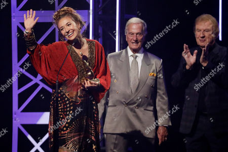 Lauren Daigle, Pat Boone, Bill Gaither. Lauren Daigle, left, accepts the song of the year award from Pat Boone, center, and Bill Gaither during the Dove Awards, in Nashville, Tenn