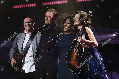 Steven Curtis Chapman, Michael W Smith, CeCe Winans, Amy Grant. Steven Curtis Chapman, left; Michael W. Smith, second from left; CeCe Winans, second from right; and Amy Grant, right; join together after performing during the Dove Awards, in Nashville, Tenn