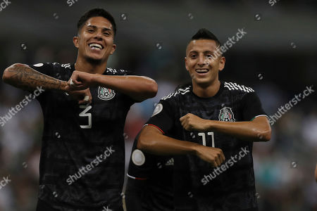 Mexico's Roberto Alvarado, right, celebrates scoring his side's first goal against Panama with teammate Carlos Salcedo during a CONCACAF Nations League soccer match at Azteca stadium in Mexico City