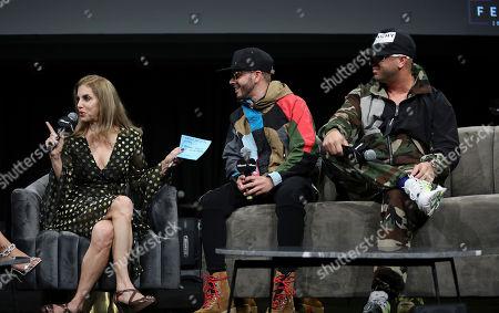 Leila Cobo and Juan Luis Morera Luna & Yandel