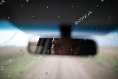 Farmer Juan Rossi is reflected in his rearview mirror on the outskirts of Pergamino, Argentina. Farmers like Rossi are bracing for a return of interventionist policies if a populist ticket returns to power. Export restrictions under former President Cristina Fernandez triggered a revolt by farmers in 2008 in one of the world's top suppliers of grains