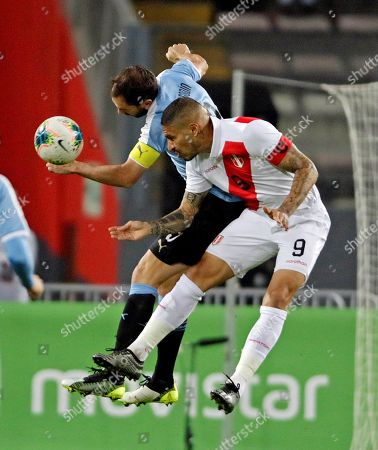 Stock Photo of Diego Godin (L) of Uruguay in action against Paolo Guerrero (R) of Peru during a friendly soccer match between Uruguay and Peru at Estadio Nacional in Lima, Peru, 15 October 2019.
