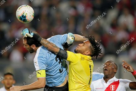 Diego Godin (C-L) of Uruguay in action against Pedro Gallese (C-R) of Peru during a friendly soccer match between Uruguay and Peru at Estadio Nacional in Lima, Peru, 15 October 2019.
