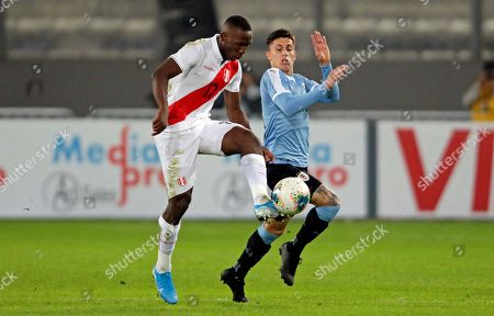 Stock Image of Brian Rodriguez (R) of Uruguay in action against Luis Advincula (L) of Peru during a friendly soccer match between Uruguay and Peru at Estadio Nacional in Lima, Peru, 15 October 2019.