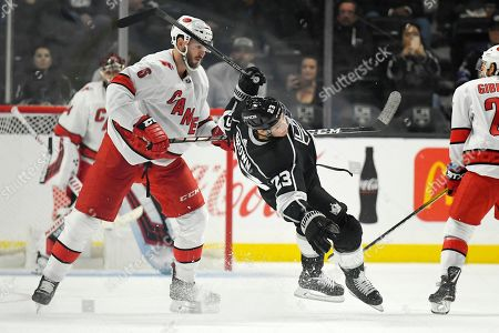 Dustin Brown, Joel Edmundson. Los Angeles Kings left wing Dustin Brown falls after colliding with Carolina Hurricanes defenseman Joel Edmundson during the third period of an NHL hockey game, in Los Angeles. The Hurricanes won 2-0
