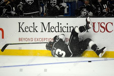 Los Angeles Kings center Tyler Toffoli trips into the boards during the third period of the team's NHL hockey game against the Carolina Hurricanes, in Los Angeles. The Hurricanes won 2-0