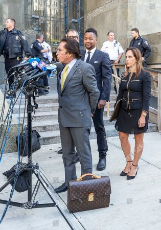 Actor Cuba Gooding Jr. listens as his attorney Mark Heller addresses the press after his arraignment at New York State Supreme Court in Manhattan