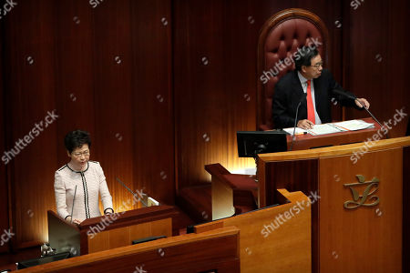 Carrie Lam, Andrew Leung. Andrew Leung, right, the President of the Legislative Council, gestures to pan-democratic legislators protesting as Hong Kong Chief Executive Carrie Lam attempts to give a policy speech at the Legislative Council in Hong Kong, . In chaotic scenes, furious pro-democracy lawmakers twice forced Hong Kong's leader to stop delivering a speech laying out her policy objectives and clamored for her to resign after she walked out of the legislature on Wednesday and then delivered the annual address 75 minutes late via television