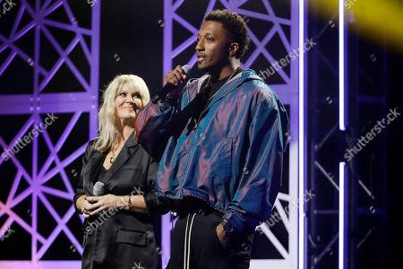 Stock Image of Lecrae, right, and Natalie Grant speak during the Dove Awards, in Nashville, Tenn