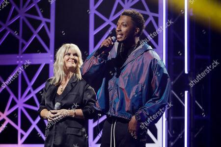 Lecrae, right, and Natalie Grant speak during the Dove Awards, in Nashville, Tenn