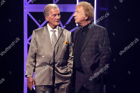 Pat Boone, left, and Bill Gaither announce an award during the Dove Awards, in Nashville, Tenn