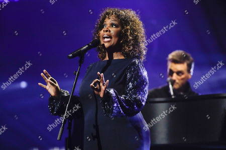 CeCe Winans performs during the Dove Awards, in Nashville, Tenn