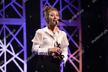 Lauren Daigle accepts the artist of the year award during the Dove Awards, in Nashville, Tenn