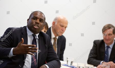 British Labour Party MP David Lammy, left, brought to Brussels by the campaign group Best for Britain, speaks to the media at the IPC building in Brussels, . European Union and British negotiators have failed to get a breakthrough in the Brexit talks during a frantic all-night session and will continue seeking a compromise on the eve of Thursday's crucial EU summit