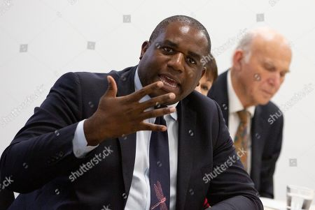 British Labour Party MP David Lammy, brought to Brussels by the campaign group Best for Britain, speaks to the media at the IPC building in Brussels, . European Union and British negotiators have failed to get a breakthrough in the Brexit talks during a frantic all-night session and will continue seeking a compromise on the eve of Thursday's crucial EU summit