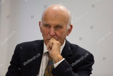 British MP Vince Cable, brought to Brussels by the campaign group Best for Britain, poses prior to speaking with the media at the IPC building in Brussels, . European Union and British negotiators have failed to get a breakthrough in the Brexit talks during a frantic all-night session and will continue seeking a compromise on the eve of Thursday's crucial EU summit