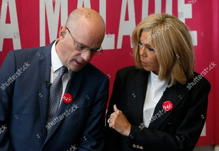 Brigitte Macron, wife of French President Emmanuel Macron, gives a dictation to school children in support of ELA, European Leucodystrophie Association, at a school in Paris. Brigitte Macron, wife of French President Emmanuel Macron, speaks with French Education and Youth Affairs Minister Jean-Michel Blanquer during a dictation to school children in support of ELA, European Leucodystrophie Association, at a school in Paris